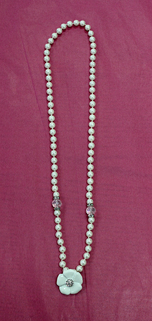 Pearl Strand With White Flower